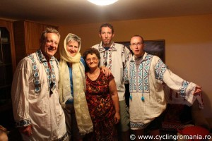 Cyclists-trying-Romanian-traditional-suits