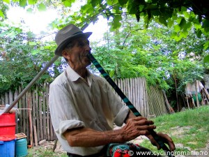 Local-villager-playing-his-flute